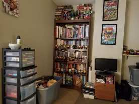 My overflowing bookcase and Funko Pop figures!